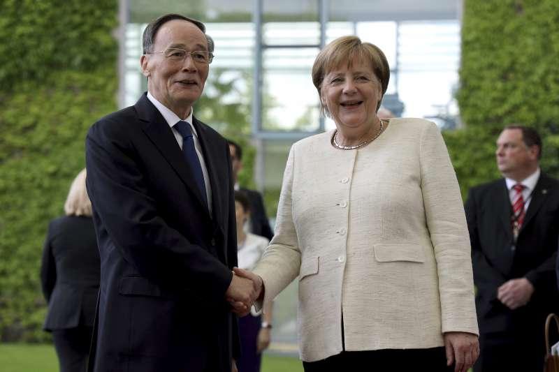 2019年5月31日,六四30周年前夕,中國國家副主席王岐山訪問柏林,會見德國總理梅克爾(AP)