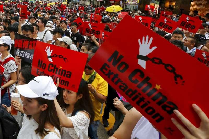 香港「民間人權陣線」9日發起反對修訂《逃犯條例》的反送中大遊行。(資料照,美聯社)