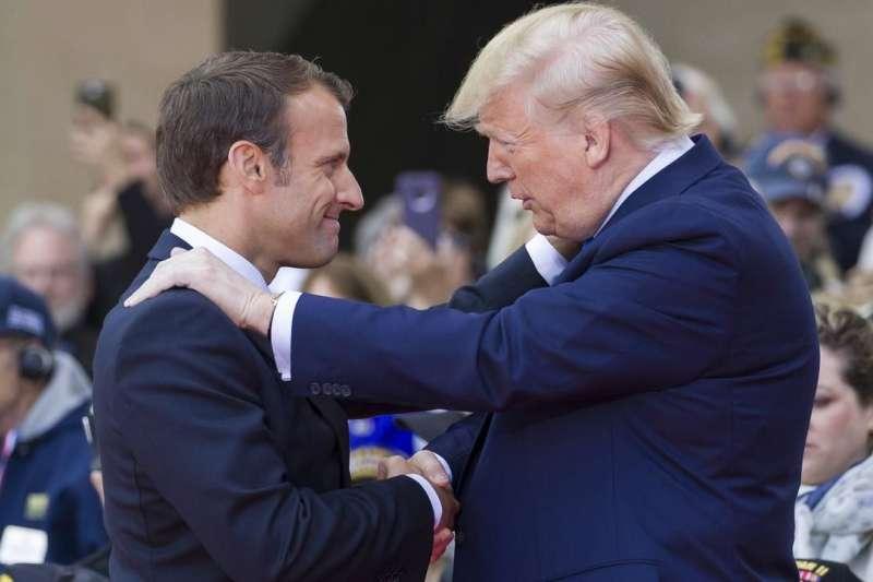 美國總統川普與法國總統馬克宏。美國貿易代表署宣布,將對法國的數位服務稅法案啟動「301調查」,美法貿易戰山雨欲來。(AP)
