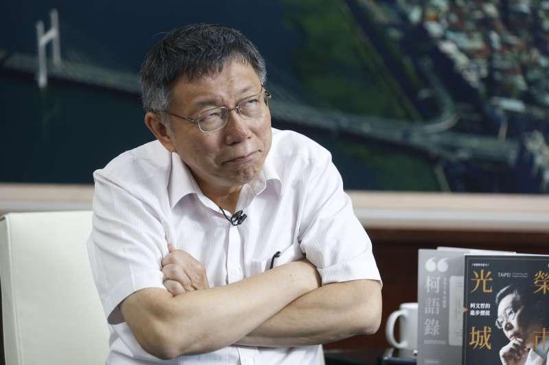 選不選總統?受訪結束時台北市長柯文哲笑說:你們還是不知道我到底要不要選?哈哈,因為我自己也不知道。」(郭晉瑋攝)