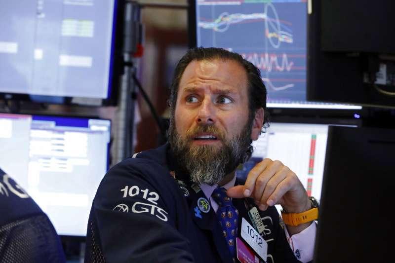 股市日益變成一個由演算法互相角力的無聲戰場,人類思維智慧想要與其鬥快。只是徒勞。(美聯社)