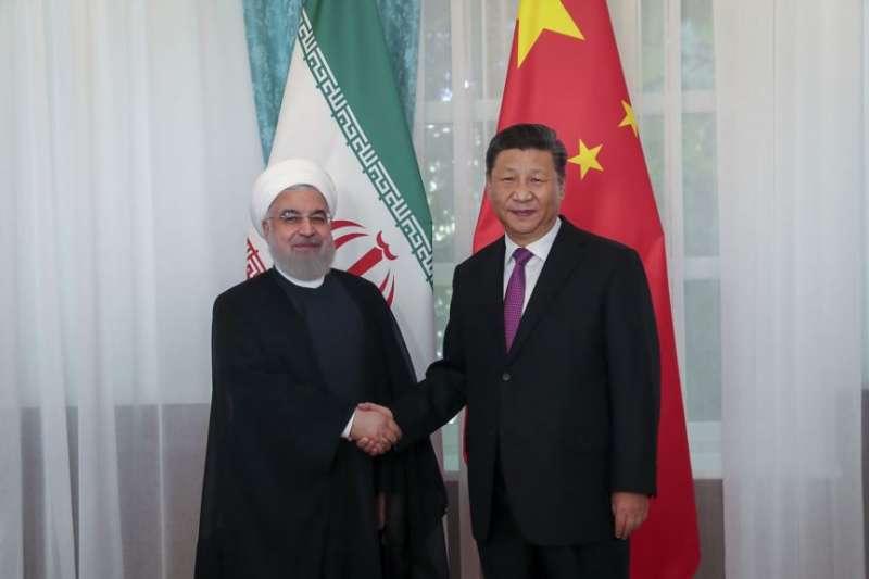 中國國家主席習近平與伊朗總統魯哈尼。(美聯社)
