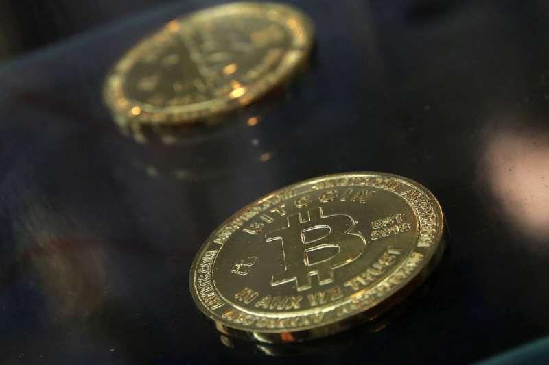 比特幣價格19日應聲下跌,3個多月來首度摜破4萬美元。(資料照,美聯社)