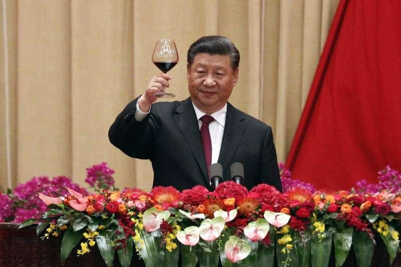 習近平在建國70週年慶典上重申要完成強國夢。(AP)