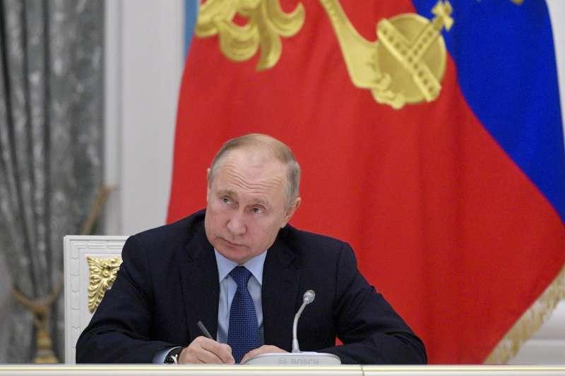 俄國總統普京日前參加俄羅斯語言會議,聲稱要用俄國百科網站取代維基百科。(AP)