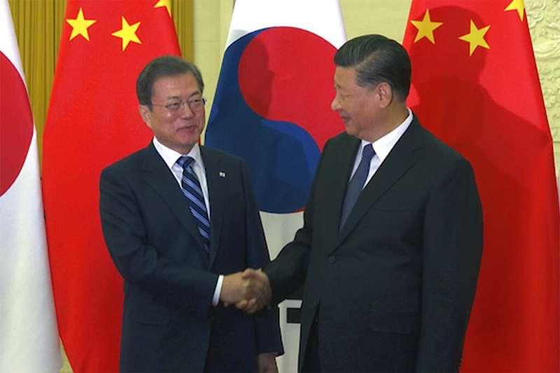 文在寅與習近平在北京會面。(資料照,美聯社)