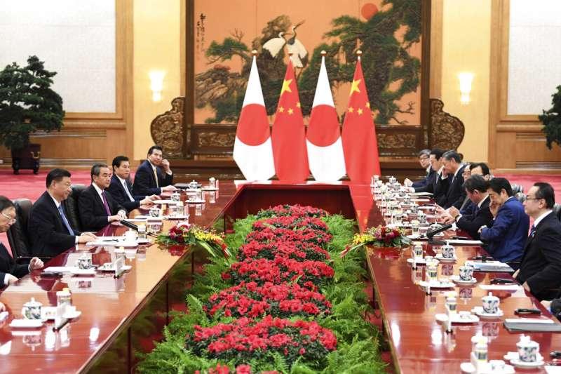 安倍晉三與習近平23日在北京會面。(美聯社)