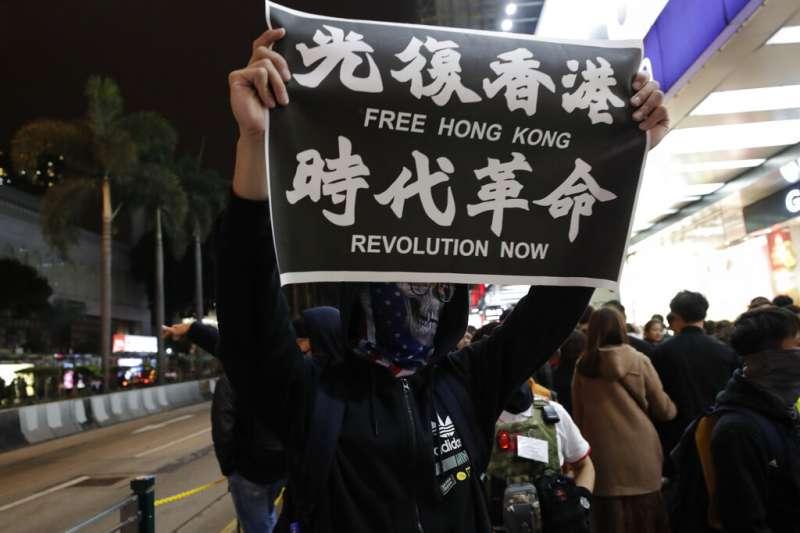 香港反送中,中港關係,一國兩制、光復香港時代革命。(美聯社)