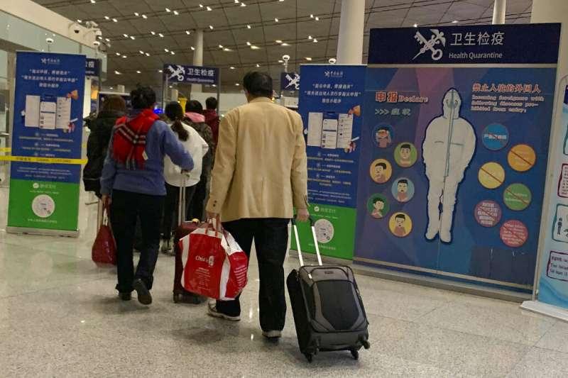 2019新型冠狀病毒(武漢肺炎)已在日本泰國傳出病例,北京海關也對出入境旅客加強查驗體溫。(美聯社)