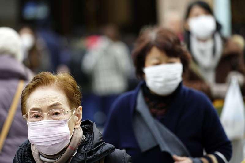 武漢肺炎,中國湖北武漢出現新型冠狀病毒引發的不明肺炎,日本、月蘭與泰國都出現案例。(AP)