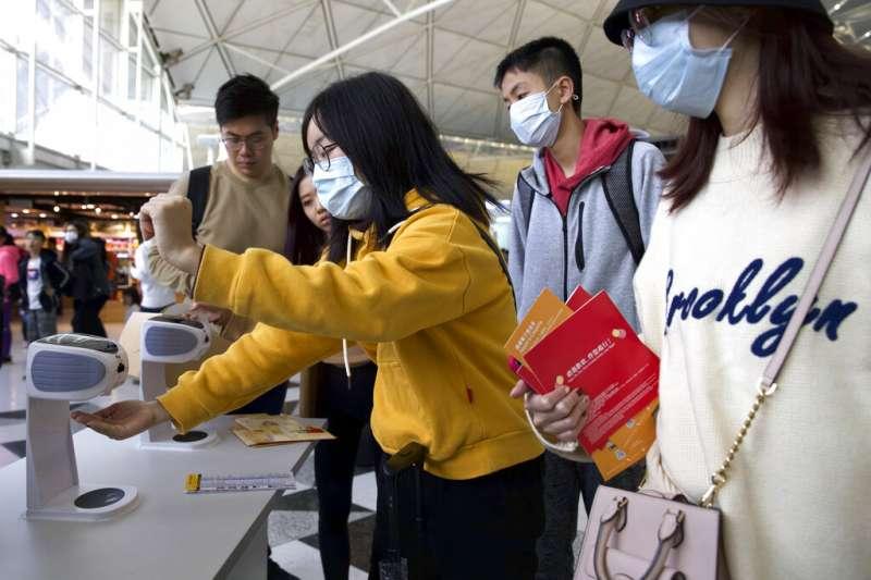 武漢肺炎疫情急遽升高,香港22日也傳出確診首例。(美聯社)