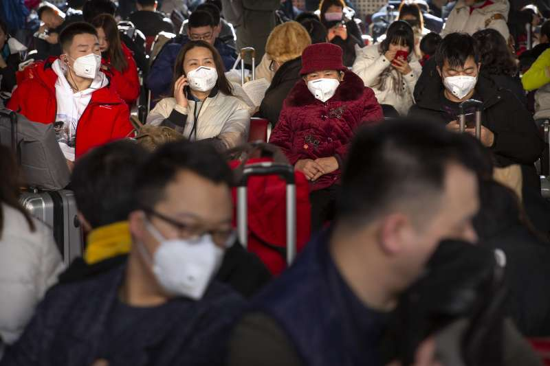 中國爆發武漢肺炎疫情,股市同受衝擊。(AP)