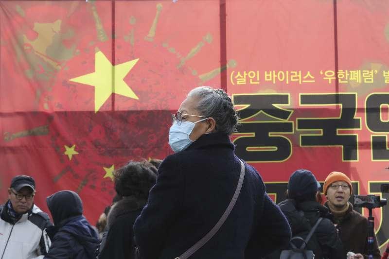 中國武漢肺炎疫情持續延燒,南韓民眾29日舉行集會,呼籲禁止中國公民入境(AP)