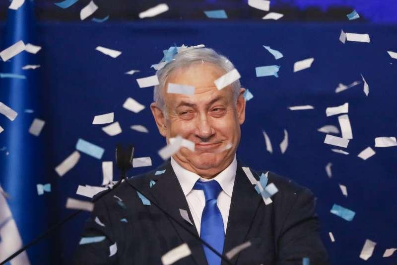 2020年3月3日,以色列國會大選,支持者歡慶現任總理納坦雅胡領導的聯合黨拿下最大黨。(AP)