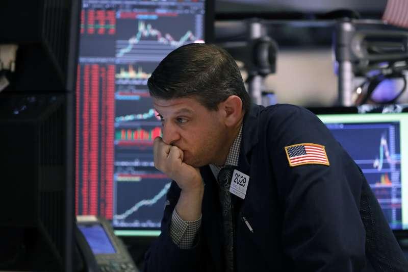 2020年3月,武漢肺炎(新冠肺炎)疫情衝擊全球經濟,美國股市慘跌(AP)