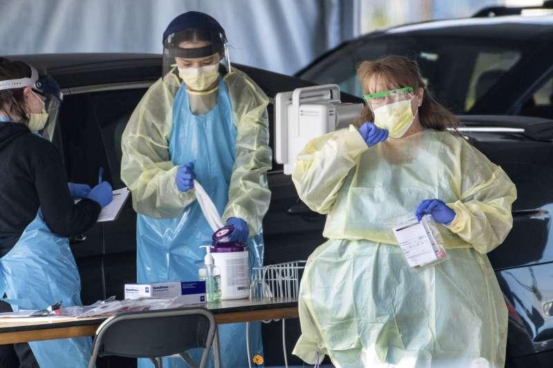新冠肺炎疫情延燒,許多國家紛紛祭出鎖國政策,呼籲民眾減少出門次數。(資料照,美聯社)