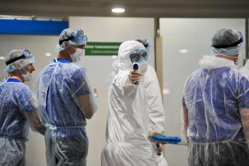 新冠肺炎疫情來襲,面對前所未有的停擺、失序與混亂,世界如何趨緩危機與減害?(資料照,AP)