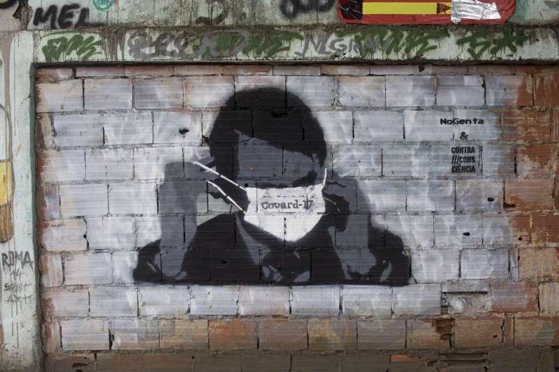 巴西街頭的博索納羅塗鴉。(美聯社)