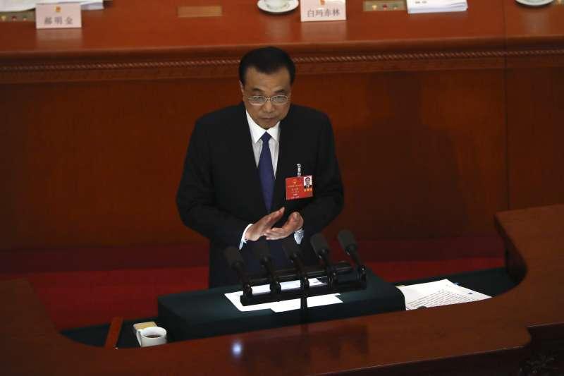 中國國務院總理李克強(見圖)在人大發布《政府工作報告》的涉台政策中並未提及和平統一及九二共識等,引發多方揣測。(資料照,美聯社)