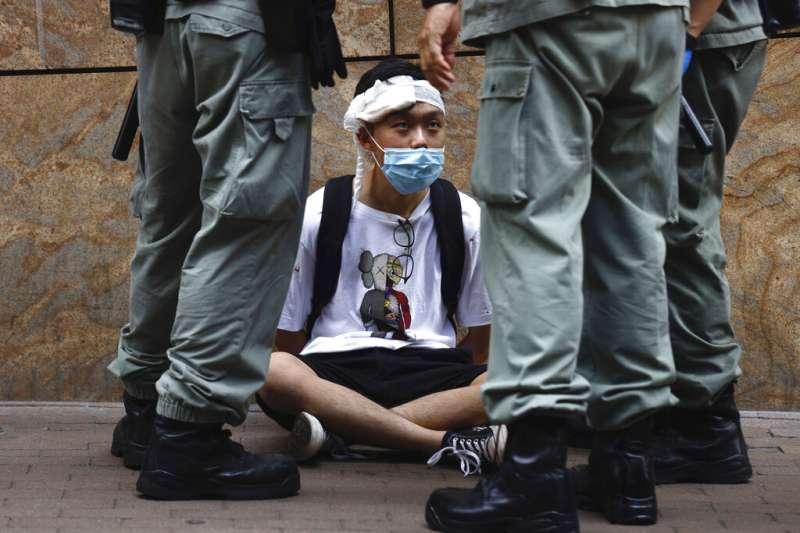 陸委會主委陳明通表示,一旦香港政府在法律上被視為執行北京意志,我方必須在《港澳條例》機制中有所回應,啟動國安防衛機制。(資料照,美聯社)