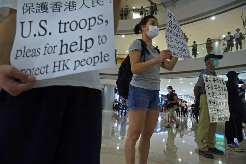 「港版國安法」與《國歌條例》爭議最近讓香港的反中國抗爭再起。(美聯社)