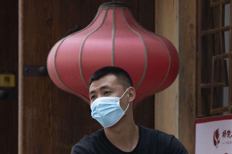 中國積極重啟經濟,但尚未脫離疫情險境,需求至少在6至12月才能回復。(AP)