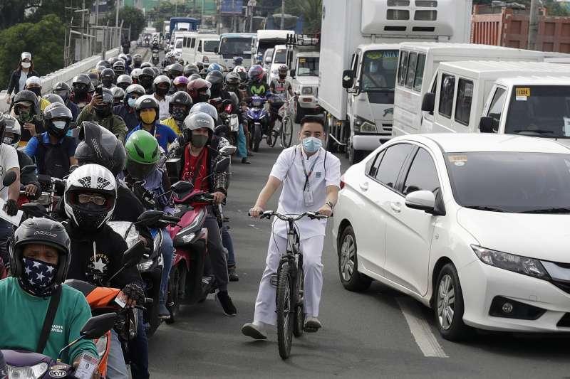 菲律賓新冠肺炎疫情持續延燒,首都馬尼拉重新封城。(AP)