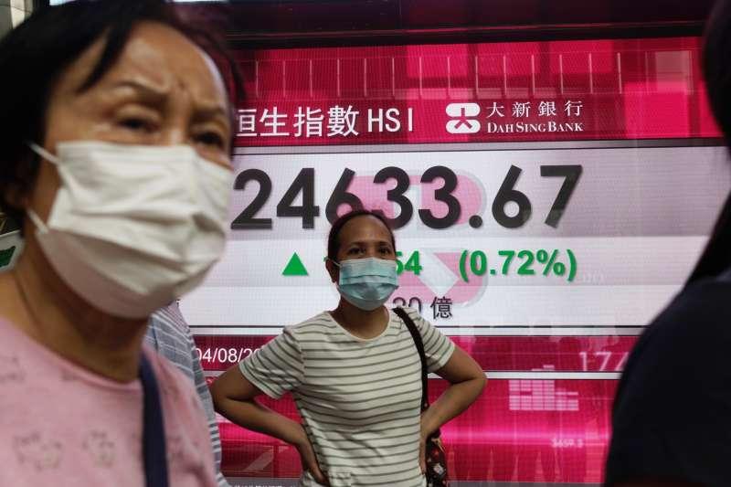 新冠肺炎疫情導致各國降息救市,意外升溫台灣房市。(AP)