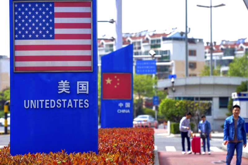 工總說的經濟「雙颱效應」中,中美貿易科技戰是影響更長且深遠的因素。(資料照片,美聯社)