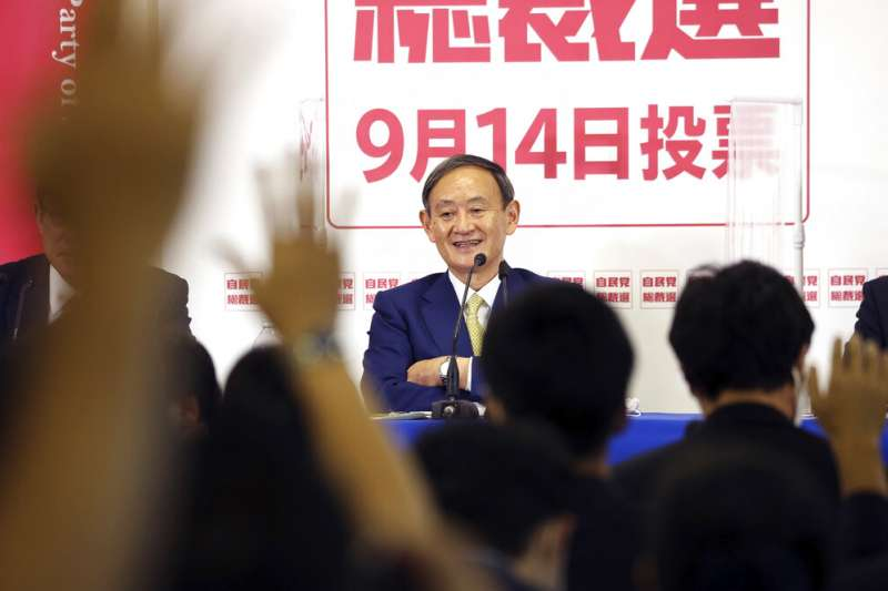 菅義偉新政權將視《港區國安法》的實施狀況,對與中國的政策做出務實的應對和調整。(美聯社)