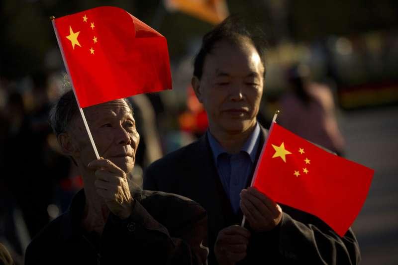 作者認為,到了現代對於自認是中國人的人來說,這個「家」的位階是高於現代概念下的「國」的。(資料照,美聯社)