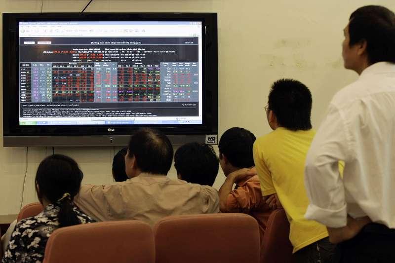 隨著市場從新冠疫情的衝擊中復甦,亞洲各地的股票交易量大幅飆升。(美聯社)