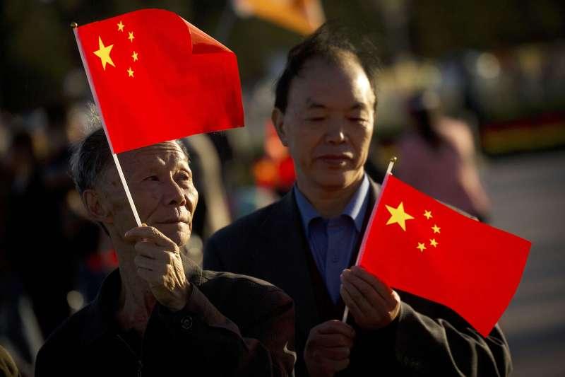 筆者認為,海外華商在此多重政治角力的背景下,不會單純憑著民族認同,支持中國民族主義、應和中國大陸的動員。(資料照,AP)
