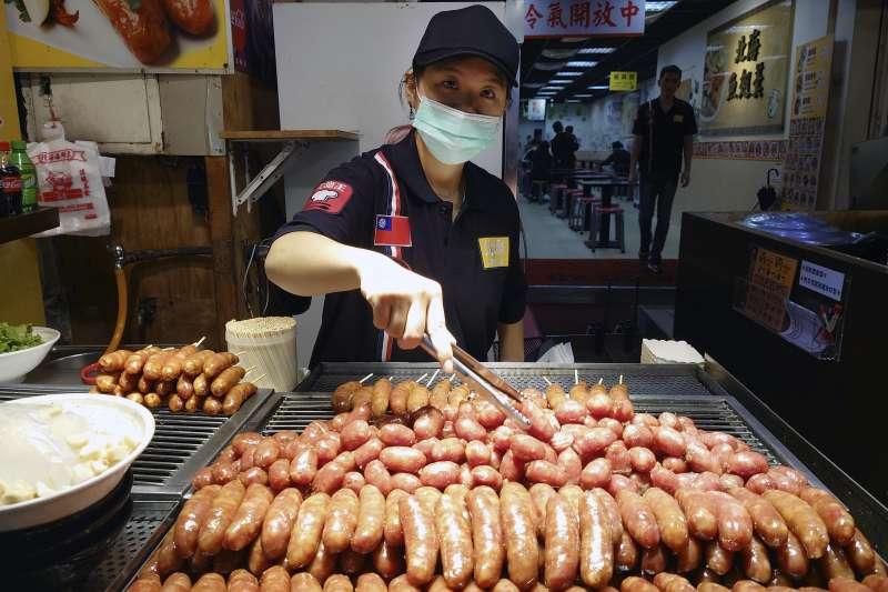 新冠肺炎疫情肆虐全球,台灣經濟表現堪稱一支獨秀。(美聯社)