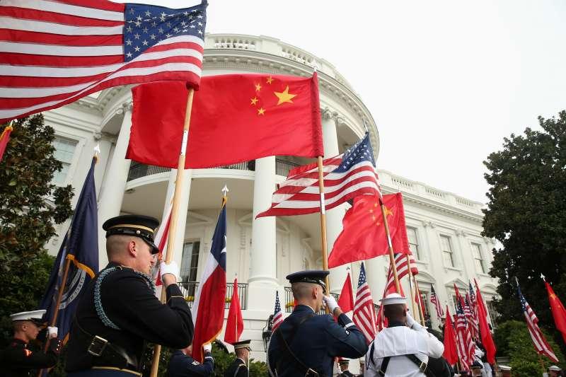 中國快速控制疫情,經濟恢復上也超越美國。(示意圖,美聯社)
