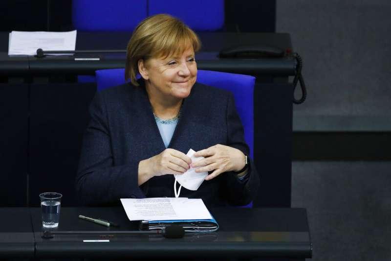 作者認為拜登勝選美國總統後,德國總理梅克爾就不需擔心美國會傷害盟友的利益。(資料照,美聯社)