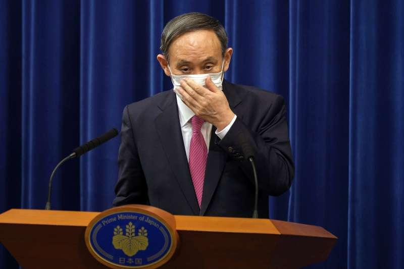 2020年12月,變種新冠病毒進入日本,首相菅義偉的政府如臨大敵(AP)