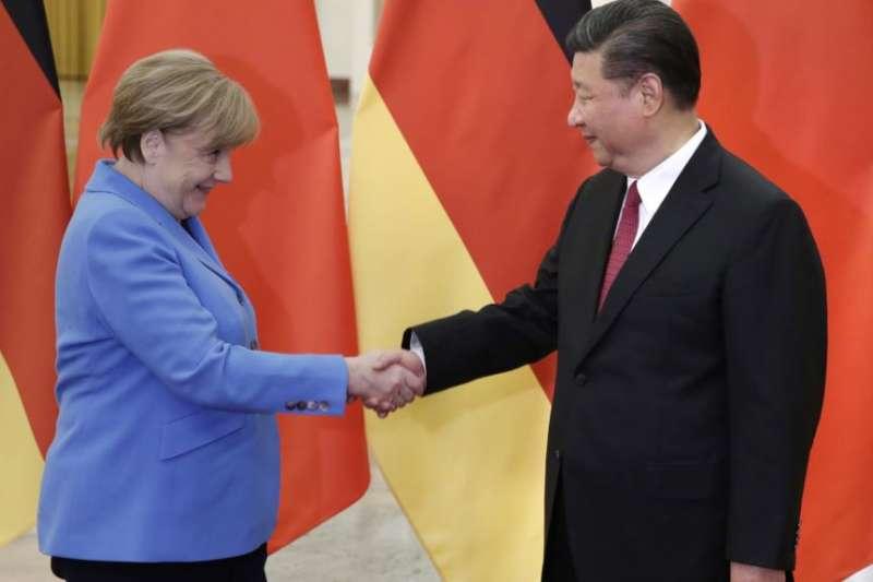 中國國家主席習近平與德國總理梅克爾。(資料照,美聯社)