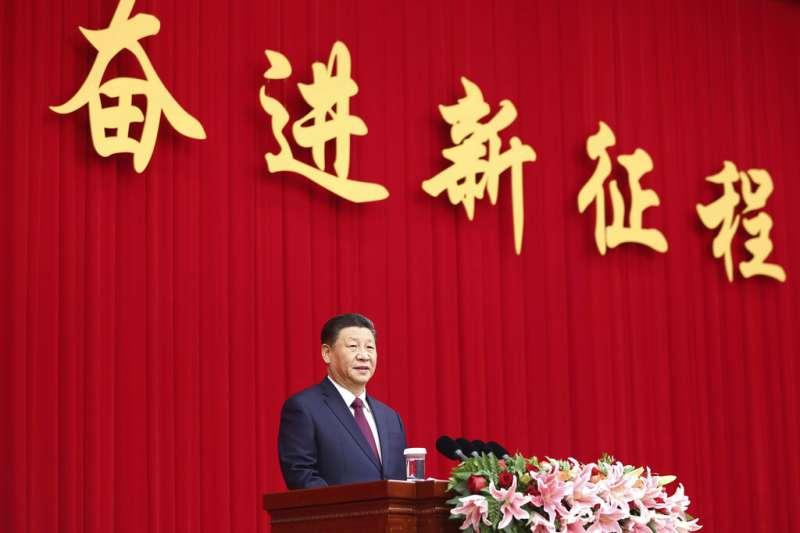 中國國家主席習近平在人民政治協商會議的新年聚會發表談話。(美聯社)