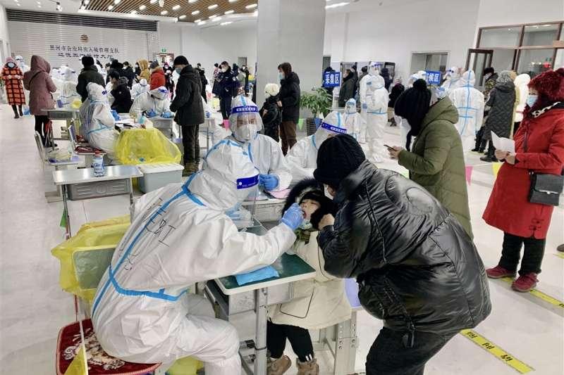 中國黑龍江省綏化市政府11日通報新增武漢肺炎無症狀感染者20例,均在望奎縣。(中新社)
