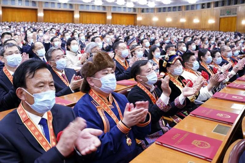 全國脫貧攻堅總結表彰大會於北京舉行。(AP)