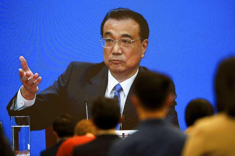 十三屆全國人大四次會議3月11日閉幕後,中國國務院總理李克強在記者會回答媒體提問。(美聯社)