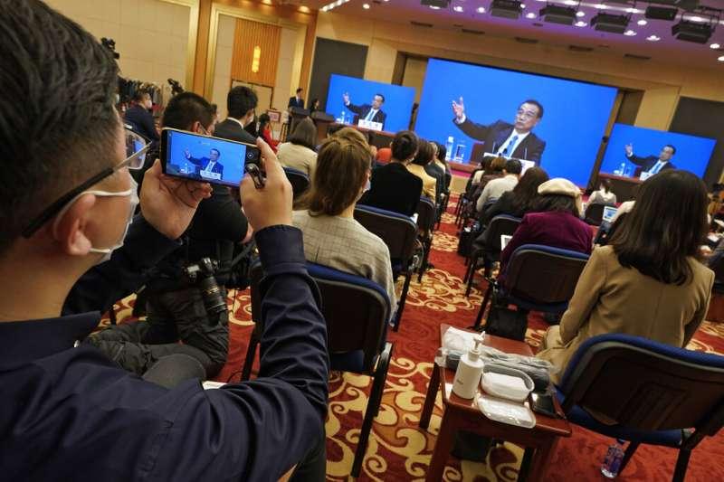 中國13屆全國人大4次會議3月11日閉幕,其間片面通過修改香港選制。(美聯社)