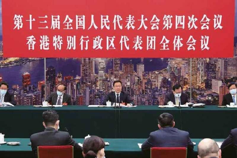 韓正在北京會見港區全國政協委員。(新華社)