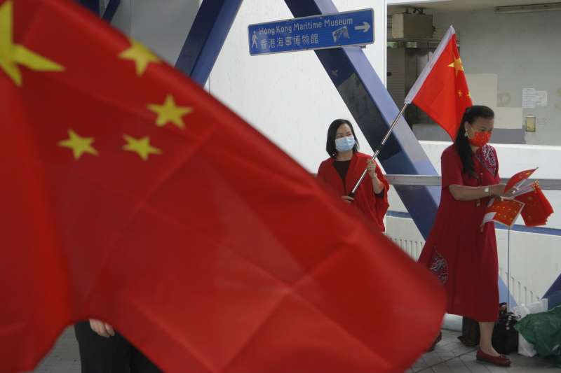2021年4月15日,《港區國安法》通過後香港首度舉行中國「國家安全教育日」。(AP)