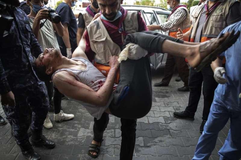 以巴衝突。在美國與埃及強力介入斡旋後,以色列與巴勒斯坦激進組織「哈瑪斯」達成停火協議,但加薩走廊死傷慘重。(AP)