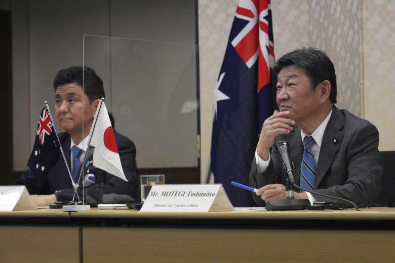 2021年6月9日,日本外務大臣茂木敏充(右)和防衛大臣岸信夫與澳洲舉行「2+2」會談,聯合聲明首度關切台海局勢(AP)