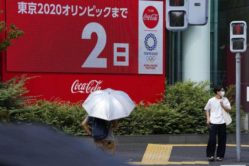 2020東京奧運遲到了一年,直到開幕前兩天官員們仍不確定能否正常舉行。(美聯社)