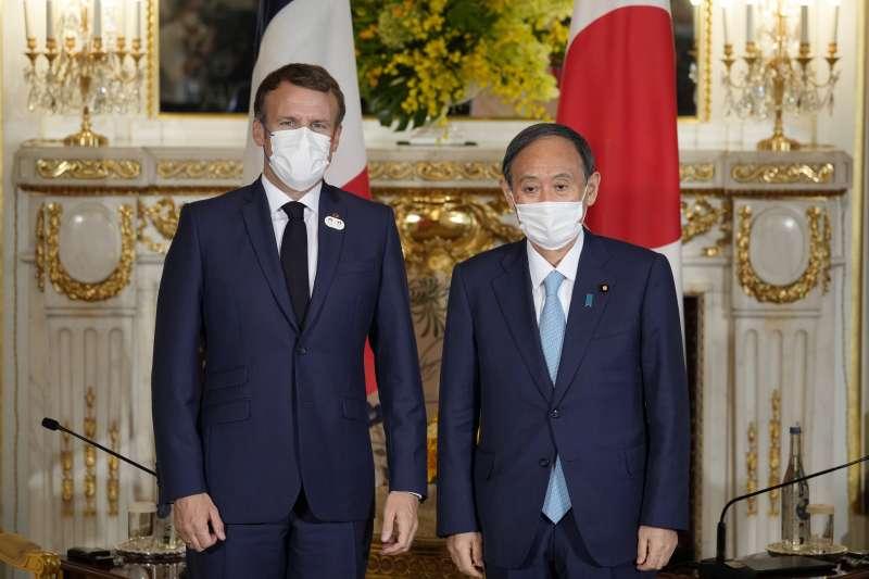 2021年7月24日,日本首相菅義偉和法國總統馬克宏會談(AP)