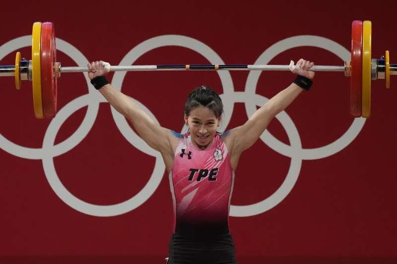 2021年7月27日,東京奧運,台灣代表隊舉重女子59公斤量級選手郭婞淳出賽,勇奪金牌(AP)